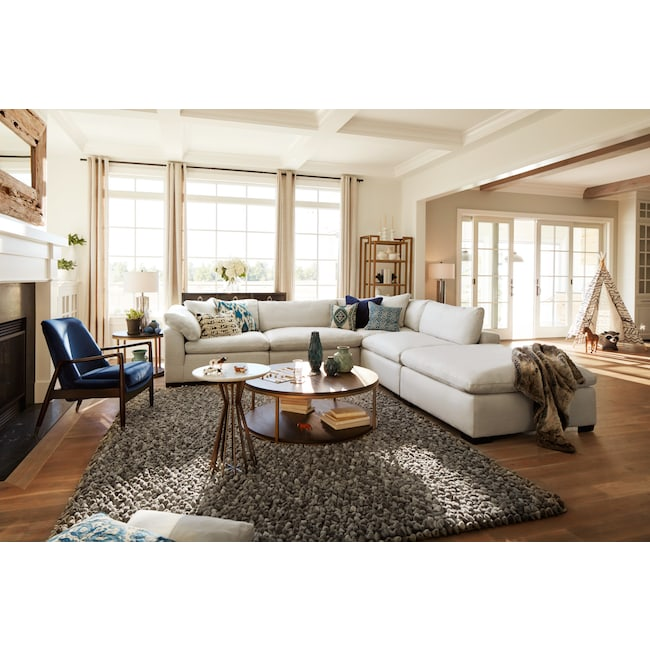 Plush 4 piece sectional and ottoman anders ivory value for Plush living room furniture