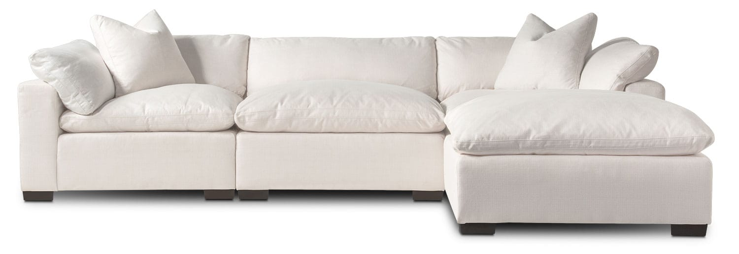 Plush 3-Piece Sectional And Ottoman - Anders Ivory